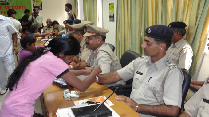TYING THE DOSTI BAND TO ALL SHO OF GURGAON POLICE - CHILDLINE SE DOSTI CAMPAIGN